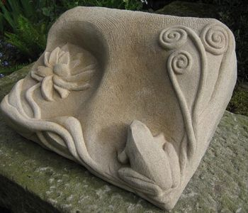 A grave marker sculpture carved from sandstone